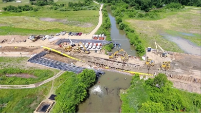 Michels Dewatering group was tasked to design, install and operate a system to divert peak flows of up to 168,000 gallons per minute, or 242 million gallons per day, so that a pipeline could be open cut in dry conditions across the Conotton Creek.