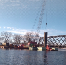 Michels installed drilled shafts into the Fox River to facilitate replacement of a three span truss-swing railroad bridge.